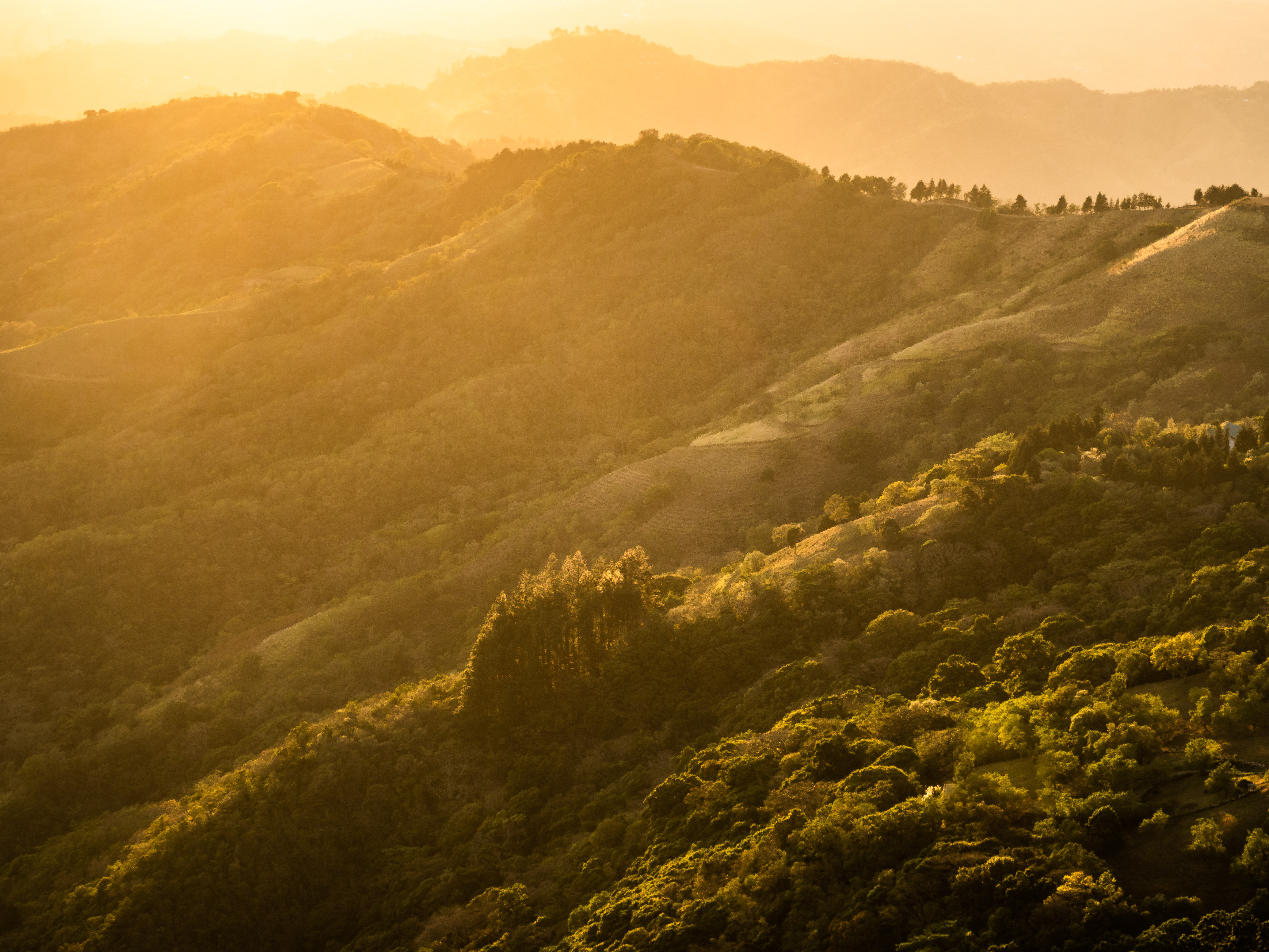 The sun sets over the hills of Santa Ana, Costa Rica