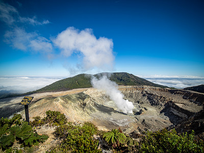 Taking care not to inhale too much sulphur while looking down into the crater of Volcán Poás, Costa Rica