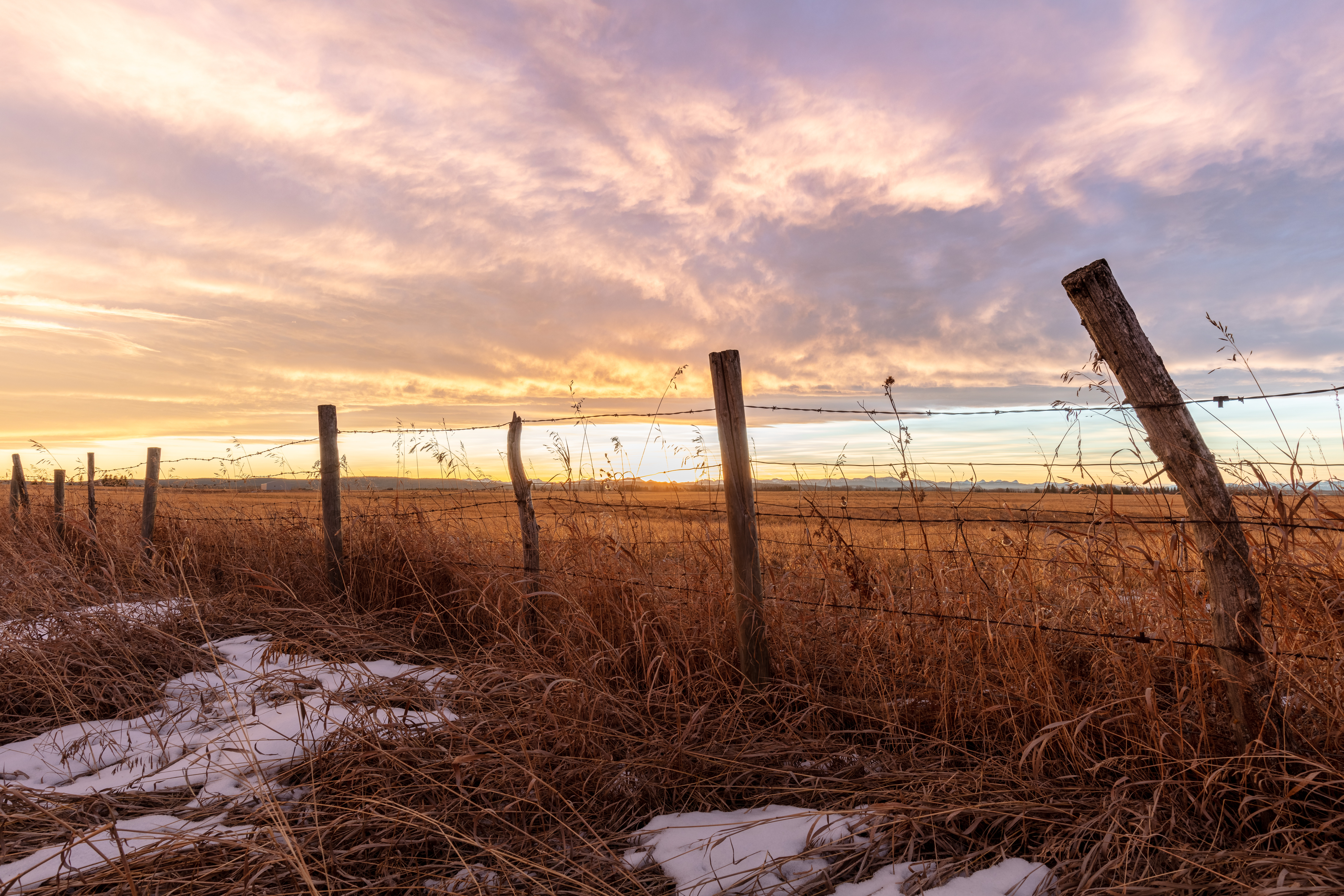 As the sun sets behind the Canadian Rockies, Alberta's big sky shows us all what she's made of