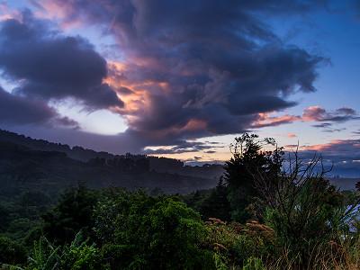 The sun starts to peek over the ridge of Poás